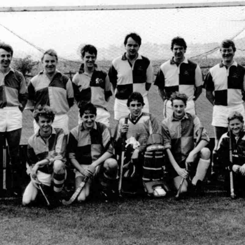 Men' second team 1990/91. Back: Colin Mitchell (umpire), James Algar, Roger Moss, Colin Watt, Mike Surtees, Mike Fox (vice captain), Front: James Alderson, Jerry Donnelly, Geoff Lewis (captain), Giles Pike, Simon Gyte (mascot).