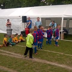 Park Regis U7's picking up their winning trophy from the Barming Youth Tournament!