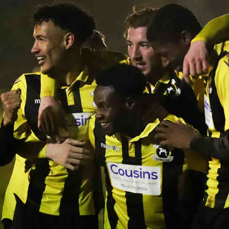 The Bees celebrate their empathic victory over Canvey Island in the Velocity Trophy match at the Cousins Car Wash Stadium