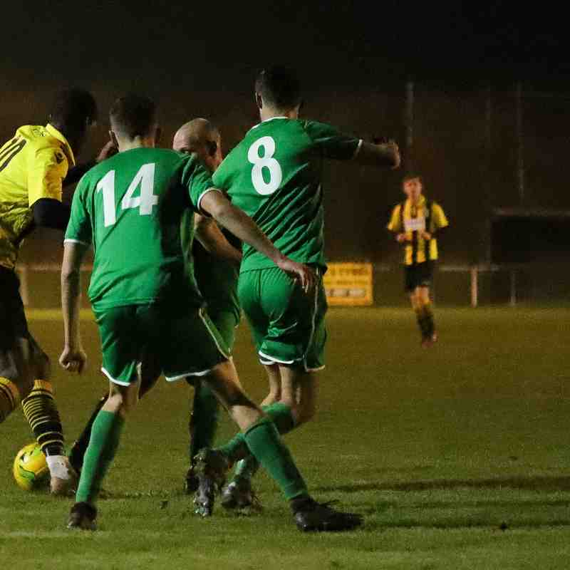Ayo Odekoya fights with the Canvey Island defence to find a way in on goal