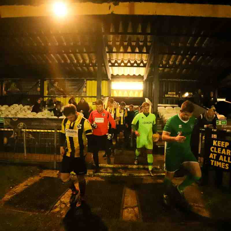 Conor Mead (left) leads the Bees out onto the Cousin Car Wash pitch ahead of their 5-3 victory over Canvey Island in the Velocity Trophy