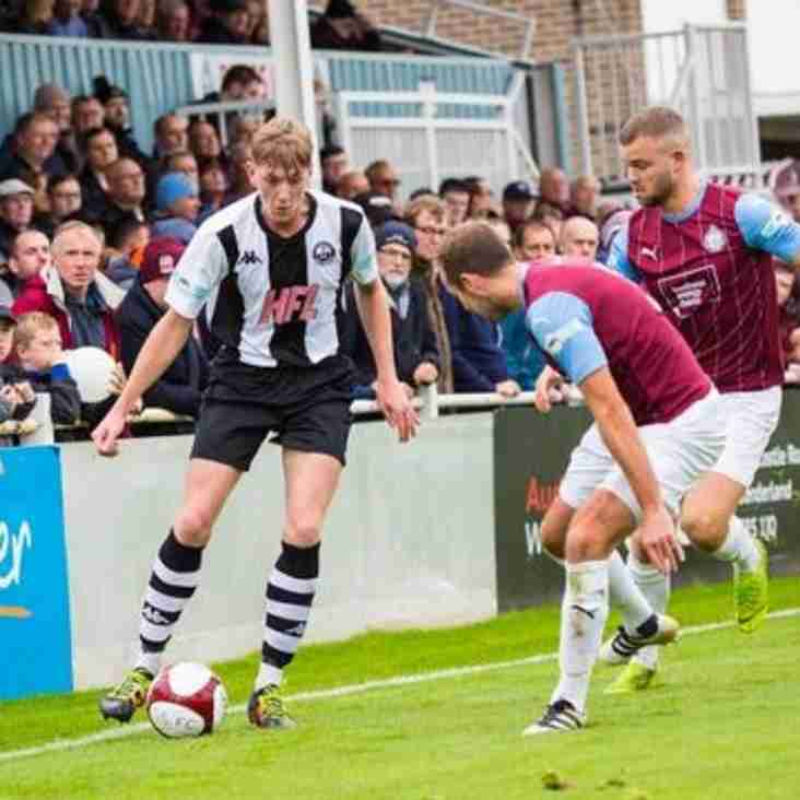Youngster signs first contract with Colls