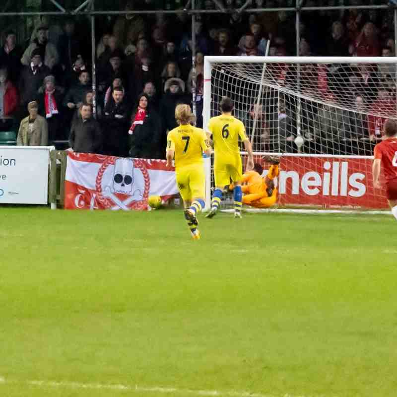 The Whitstable goalkeeper does well to block this shot, but Whitehawk score their third from the cross that followed