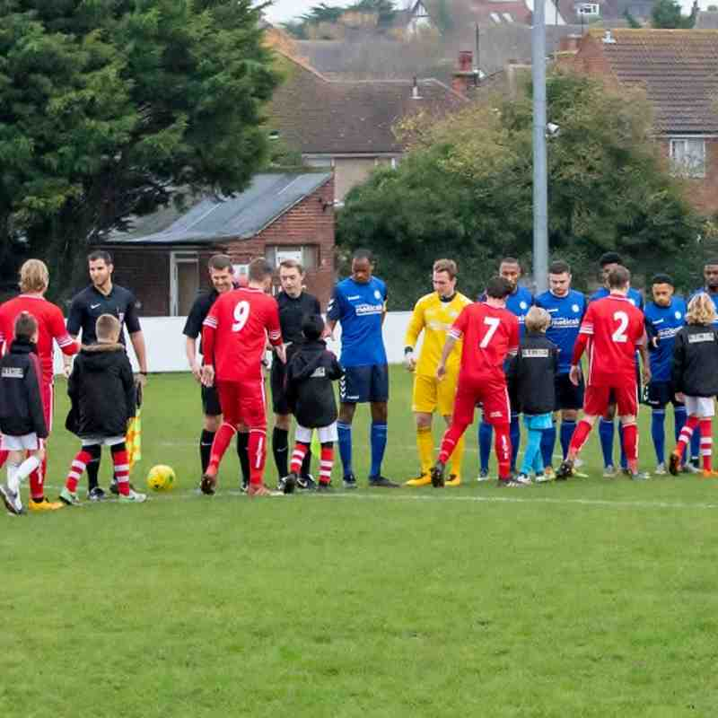 The teams meet with mascots