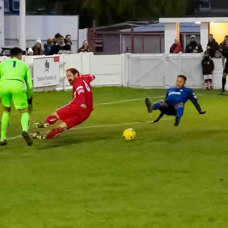 The Whyteleafe striker slips when about to shoot