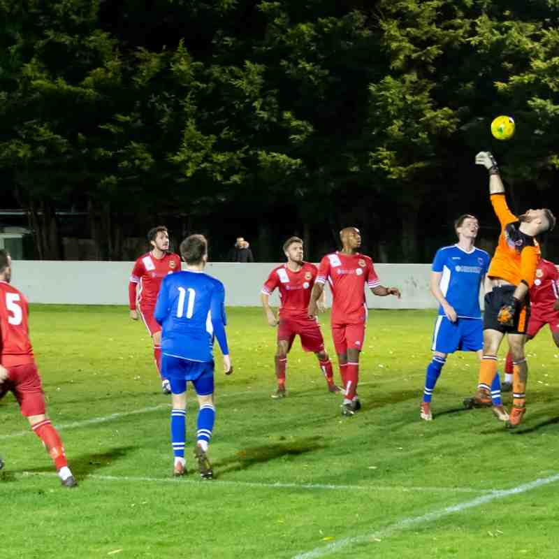Luke Watkins gets his hand to a Connor Sanders header before a defender on the line completes the clearance