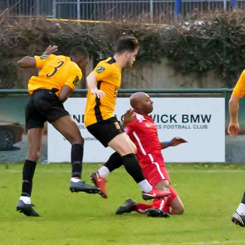 John Ufuah is brought down just outside the box