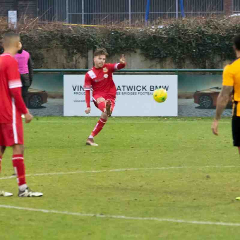 Aaron Millbank takes the free kick