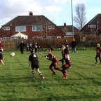 Wigan U9's v Widnes - Contender for try of the season?  U9's use the pass to create space to the delight of the spectators.
