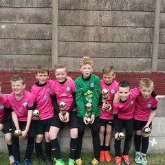 Under 9 pinks win the Ossett Albion Gala.............and celebrate!!